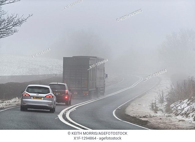 Traffic on the A44 trunk road in the fog, Powys Mid Wales UK , 29 Dec 2010  december 29 2010  Photo ©keith morris keith@artx co uk / www artswebwales com /...