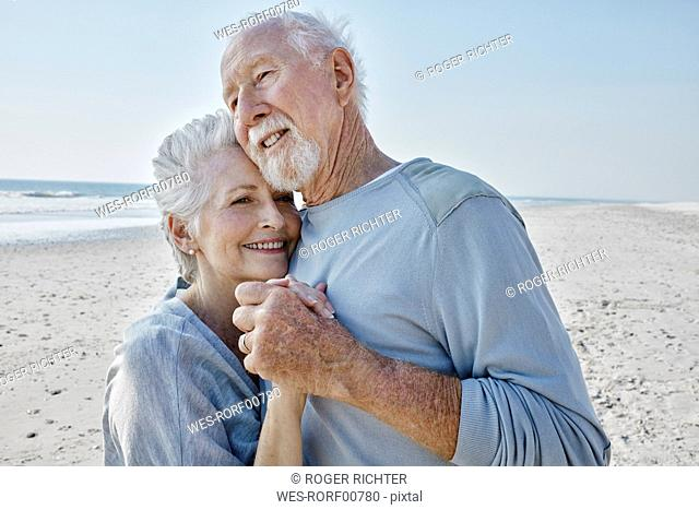 Happy senior couple dancing on the beach