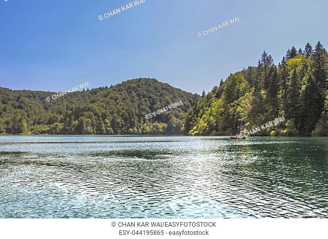 Lika-Senj County, Karlovac County, Croatia - 2013: Tourist taking a boat ride on the lakes in Plitvice Lakes National Park
