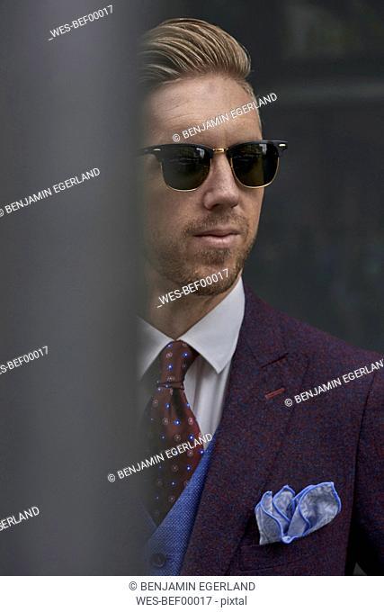 Portrait of fashion blogger Steve Tilbrook wearing sunglasses and dress handkerchief
