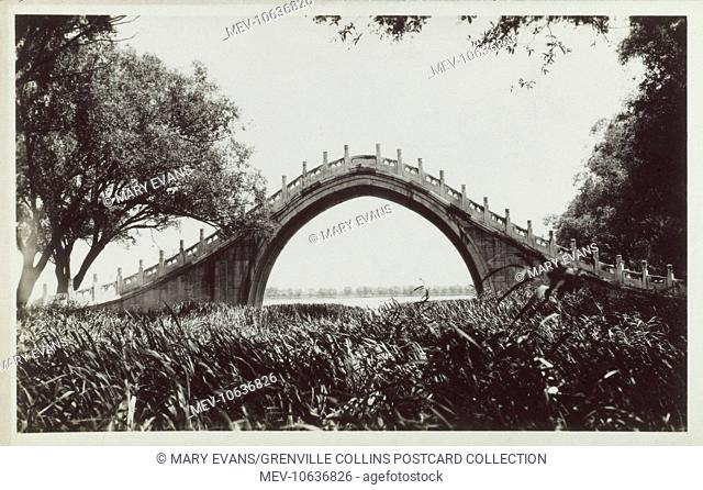 A beautiful photograph of the Stone Arch 'Jade Belt' Bridge on the Western Shore of Lake Kunming at the Summer Palace, Bejing, China