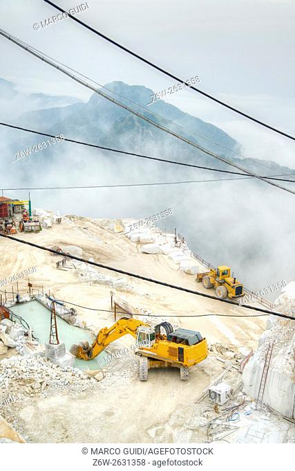 Broad view of the process in the white marble quarries in Carrara Italy