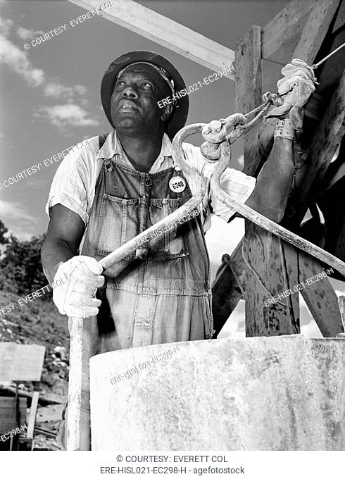African American construction worker at the Douglas Dam on the French Broad River, one of the Tennessee Valley Authority public works projects of the New Deal