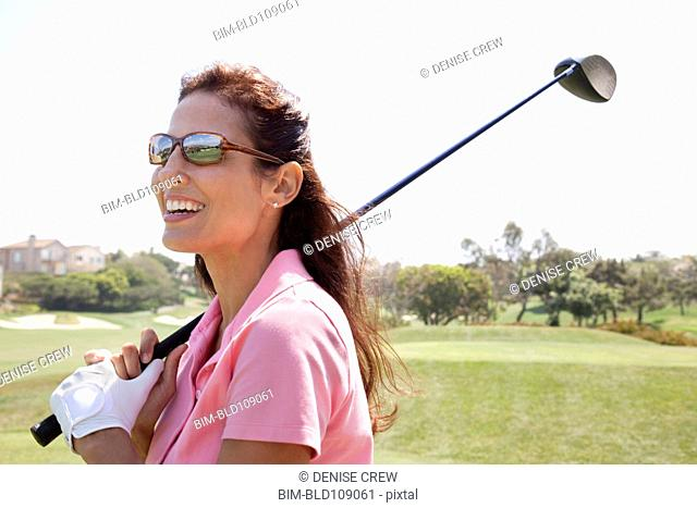 Woman playing golf on course