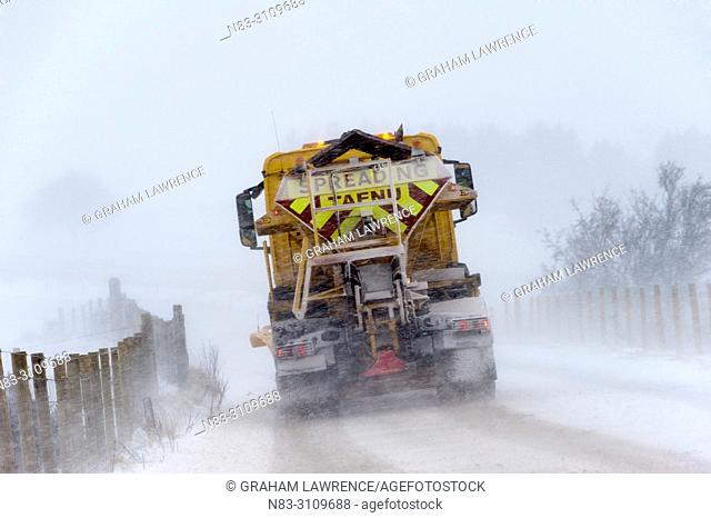 A gritter truck clears snow on the B4520 (Brecon Road) on the Mynydd Epynt moorland, near Builth Wells in Powys, Wales, UK
