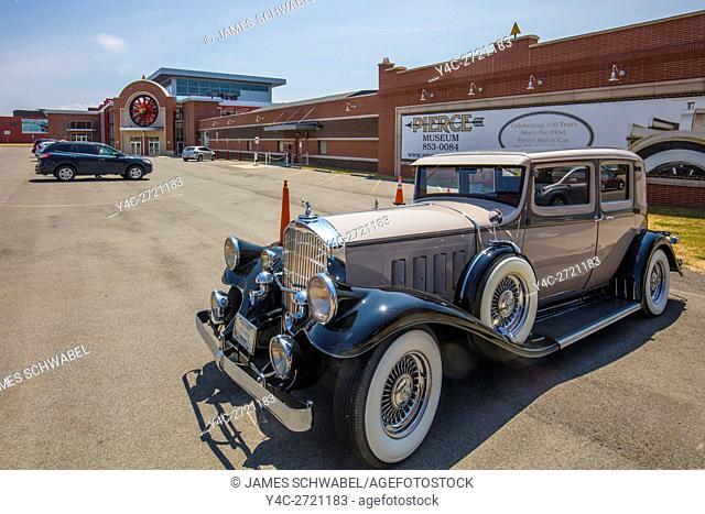 Antique Pierce Arrow cars in front of The Buffalo Transportation Pierce Arrow Museum in Buffalo New York