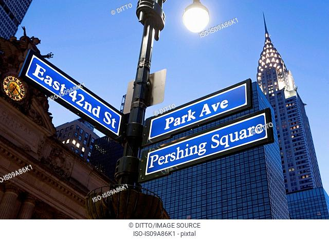 Pershing Square and Park Avenue street signs at dusk, New York City, USA