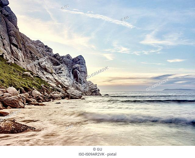 View of cliffs and blurred ocean waves, Morro Bay, California, USA