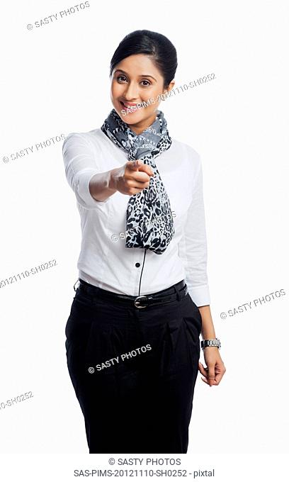 Portrait of a businesswoman pointing and smiling