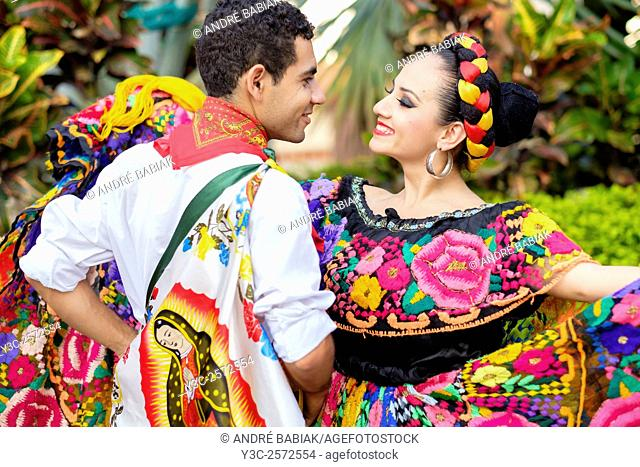Colorful Mexican costumes - Puerto Vallarta, Jalisco, Mexico. Xiutla Dancers - a folkloristic Mexican dance group in traditional costumes representing the...
