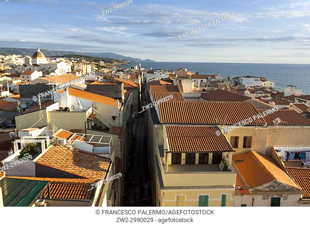 Aerial view of city against romantic skyline at sunset. Alghero, Sardinia. Italy