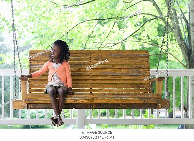 A girl sat on a swing seat
