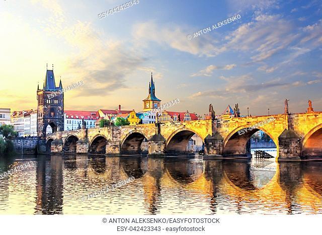Charles bridge over Vltava river in Prague at sunrise