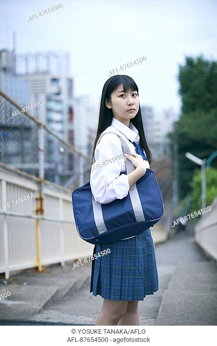Japanese high school student in uniform downtown Tokyo
