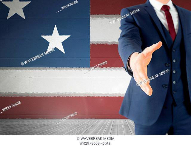 Business man shaking his hand against american flag