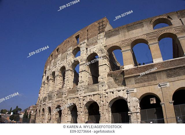 portion of exterior of Colosseum, riddled with holes - Rome, Italy