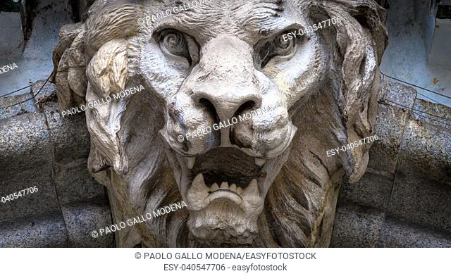 Italy, Turin. Made of stone and located on a marble arch, aroud 300 years old. Fallen angel in the shape of a roaring lion