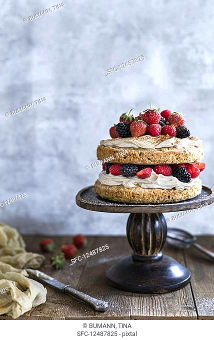 A cappuccino cake with berries