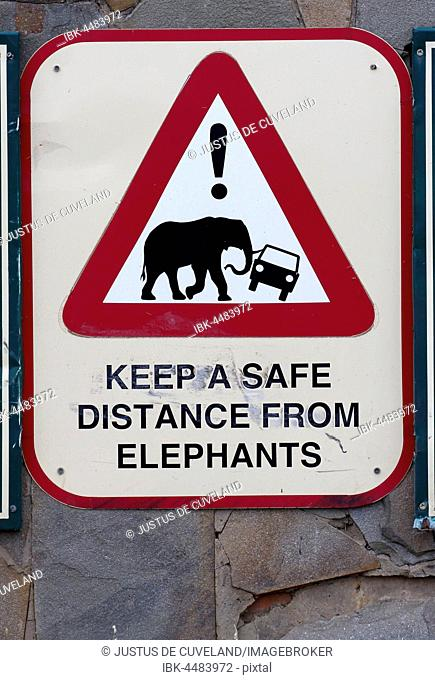 Warning sign keep safe distance from elephants, Hluhluwe-Imfolozi Park, South Africa