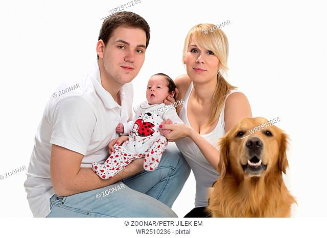 happy young family with newborn and dog on a white background