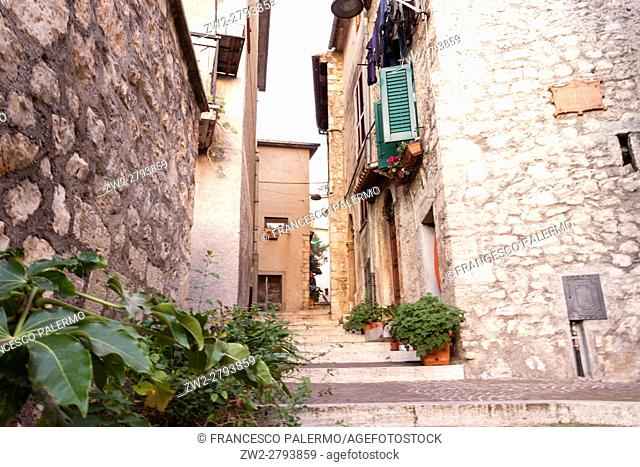 Medieval buildings in a little town illuminated with a natural gold light. Vico nel Lazio, Lazio. Italy