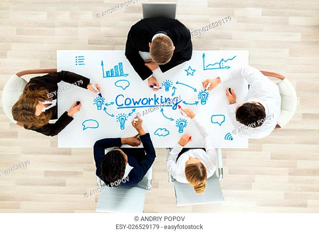 Group Of Businesspeople Together In CoWorking Space