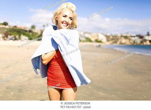 Portrait of blond woman on beach