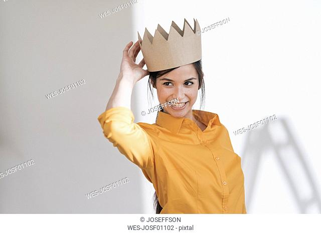 Happy young woman with crown on her head