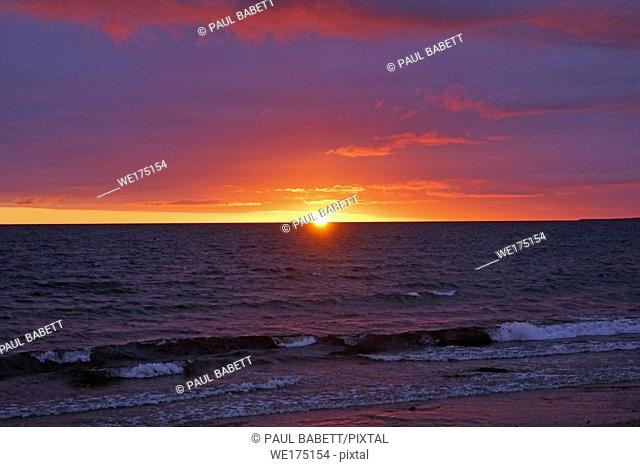 beautiful sunrise on the beach of Nairn. Nairn is a city in the Scottish Council Area Highland. It is located on the south bank of the Moray Firth about 26 km...