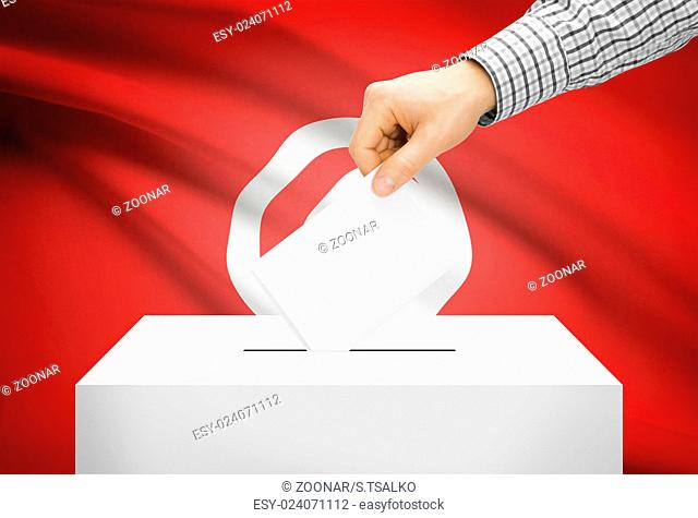 Voting concept - Ballot box with national flag on background - Tunisia
