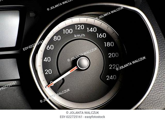 Fragment of instrument panel of car speedometer, tachometer with visible symbols of instrument cluster