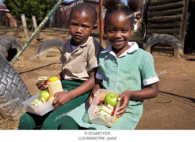 Young schoolboy and schoolgirls with their healthy packed lunch, KwaZulu Natal Province, South Africa