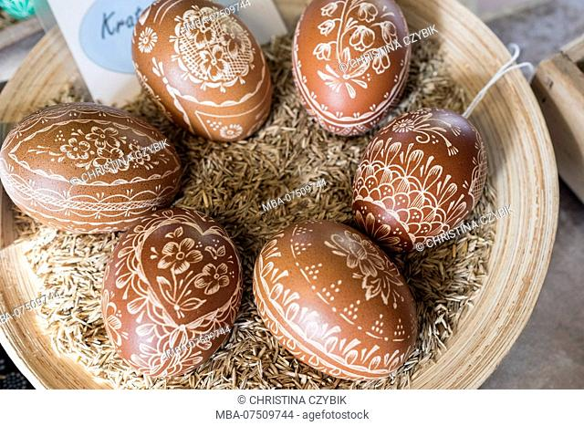 Preparing traditional Sorbian Easter eggs in Bautzen, Germany. Wax technique and salt acid with the scratch- and etching technique