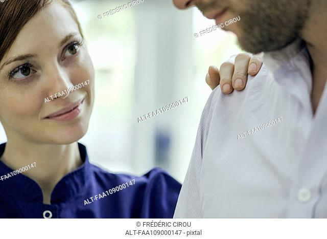 Healthcare worker reassuring patient