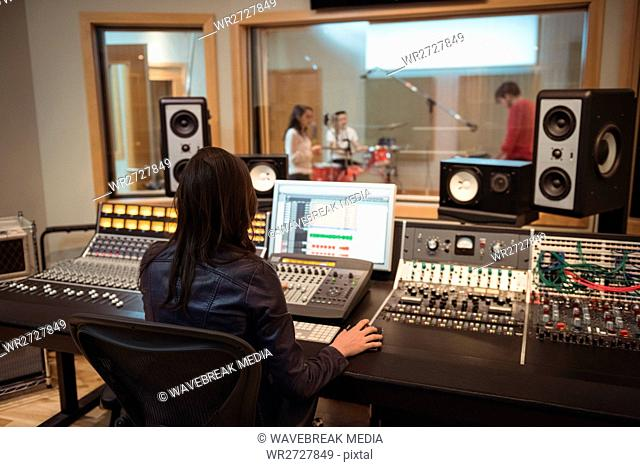 Audio engineer using sound mixer