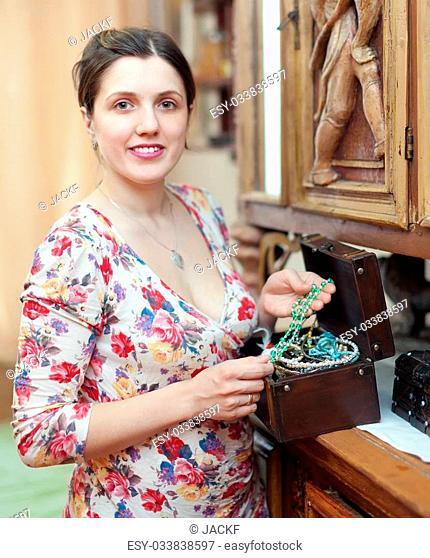 woman with treasure chest in vintage interior