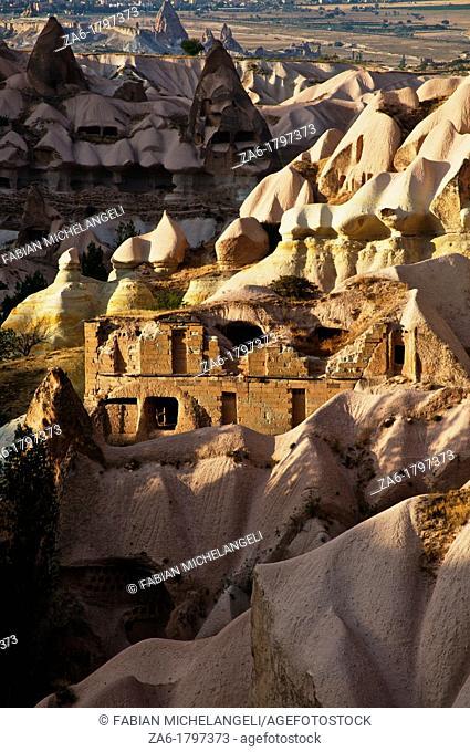 Rock-hewn cave dwellings in cliff. Pigeon Valley, Cappadocia, Anatolia, Turkey