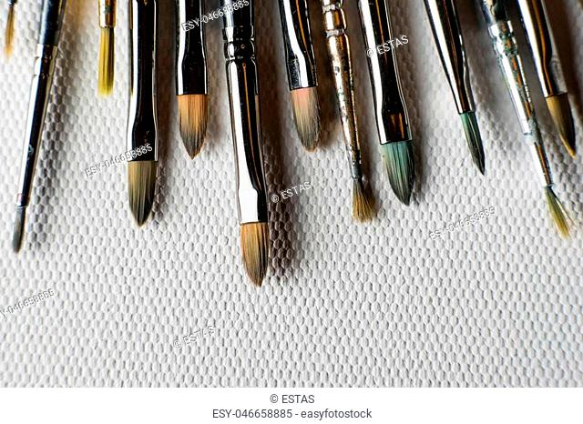a lot of brushes paint isolated on white canvas