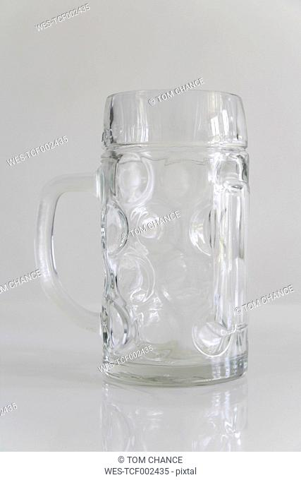Empty beer mug on white background, close up