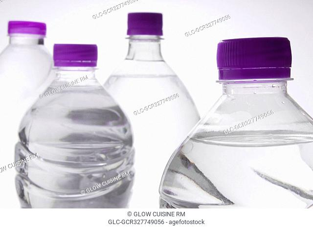 Close-up of four bottles of water