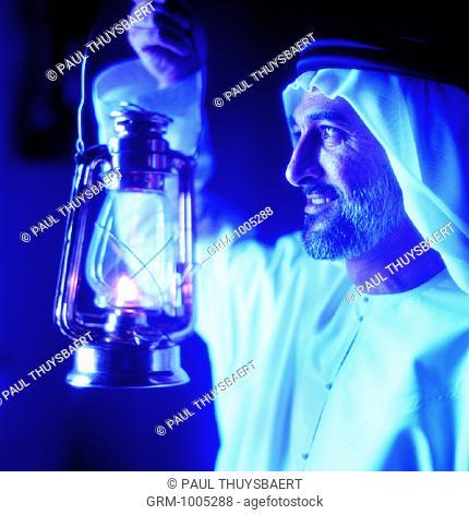 Arab man holding lantern