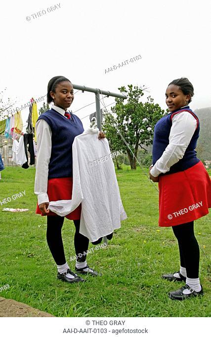 School girls hanging laundry, St Mark's School, Mbabane, Hhohho, Kingdom of Swaziland