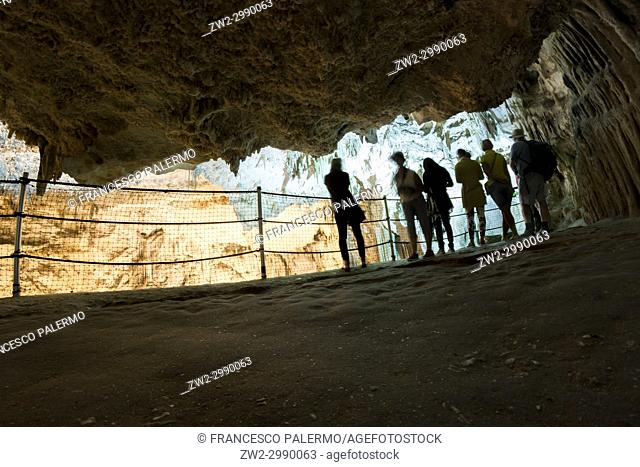 Tourists admire the incredible cave of Neptune. Alghero, Sardinia. Italy