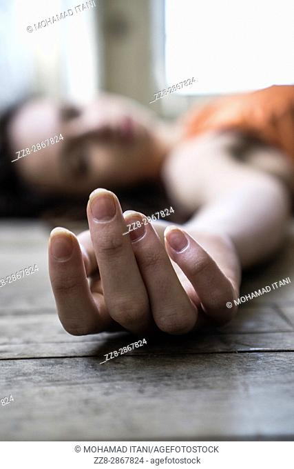 close up of a woman laying down on the floor