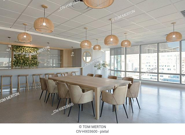 Conference table and pendant lights in modern conference room