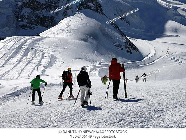skiers preparing for on sking slopes after getting out of Metro Alpin at the top of Mittelallalin 3500 m, Saas-Fee, Valais, Wallis, Switzerland