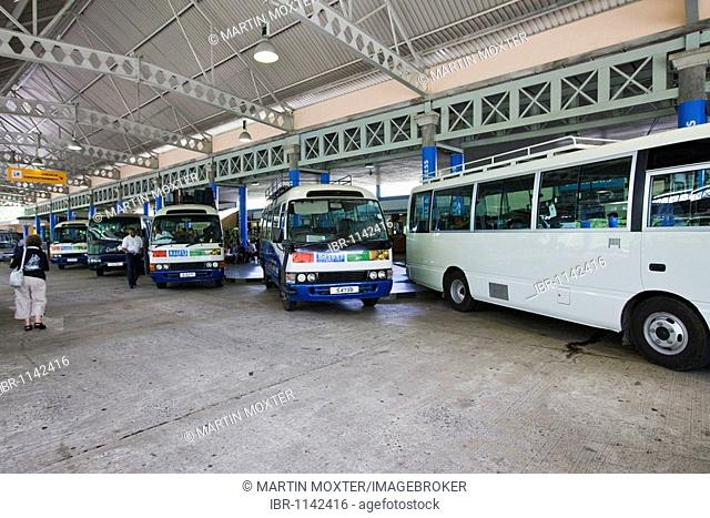 Busses for collecting tourists at the airport of the island of Mahe, Seychelles, Indian Ocean, Africa