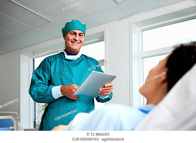 Patient and surgeon with digital tablet
