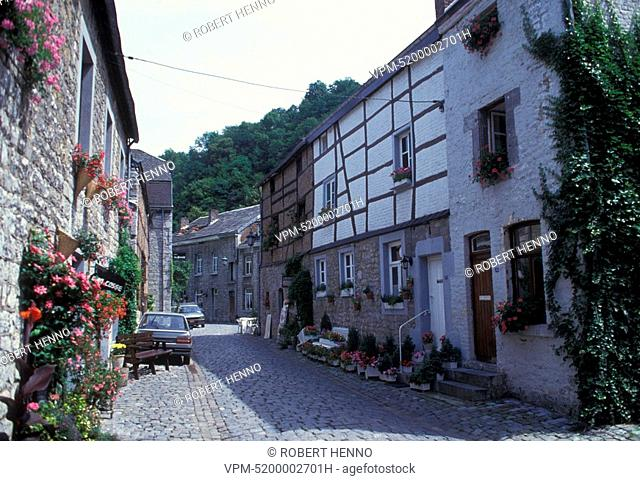 NARROW COBBLESTONES STREET AND OLD HOUSES IN THE HISTORICAL CENTER OF DURBUYTHE SMALLEST CITY IN THE WORLDARDENNE - BELGIUM