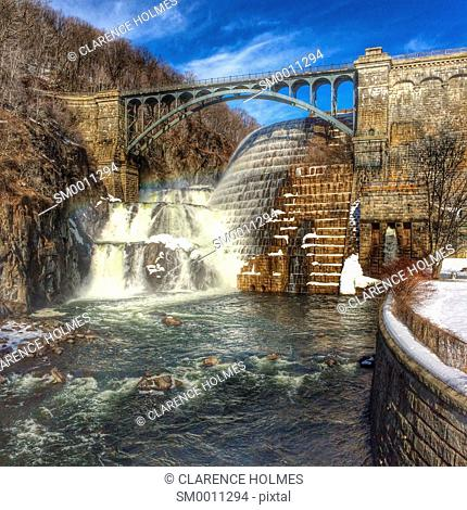 Water flows over the spillway of the New Croton dam on a warm winter day in Cortlandt, New York, USA
